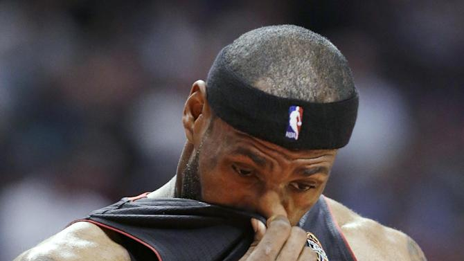Miami Heat forward LeBron James wipes his face during the first half of an NBA basketball game against the Chicago Bulls in Chicago on Wednesday, March 27, 2013. (AP Photo/Nam Y. Huh)