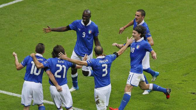 Italy's Mario Balotelli, top left, is celebrated by teammates after scoring the opening goal during the Euro 2012 soccer championship semifinal match between Germany and Italy in Warsaw, Poland, Thursday, June 28, 2012. (AP Photo/Vadim Ghirda)