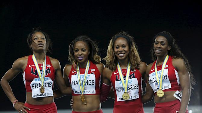 The U.S. 4x800 relay team stand on the medal podium with their gold medals at the IAAF World Relays Championships in Nassau