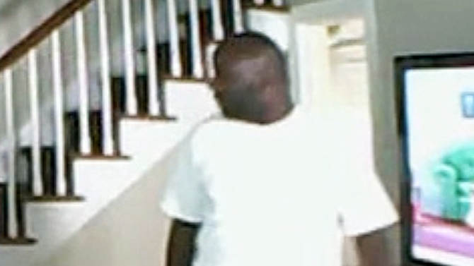 This image taken from nanny cam video footage provided by the Millburn, N.J. police shows a man who forced his way into a home in Millburn on Friday, June 21, 2013, and attacked a woman watching cartoons with her 3-year-old daughter. The camera captured the man punching and kicking the woman in a series of assaults before throwing her down the basement stairs and nonchalantly walking out the front door, police said. (AP Photo/Millburn Police)