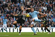 Edin Dzeko swooped three minutes from time to give Manchester City victory