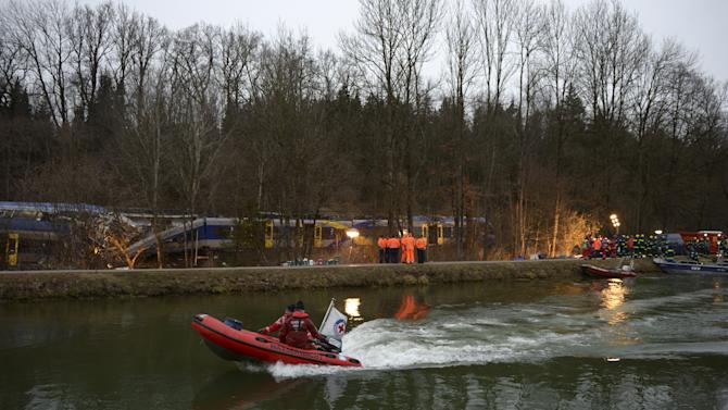 A boat with rescue workers is seen in front of two crashed trains near Bad Aibling in southwestern Germany