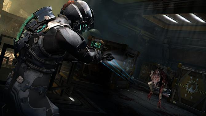 """In this publicity image released by Electronic Arts, Isaac Clarke fires at a necromorph in a scene from the sci-fi horror action game """"Dead Space 2."""" (AP Photo/Electronic Arts)"""