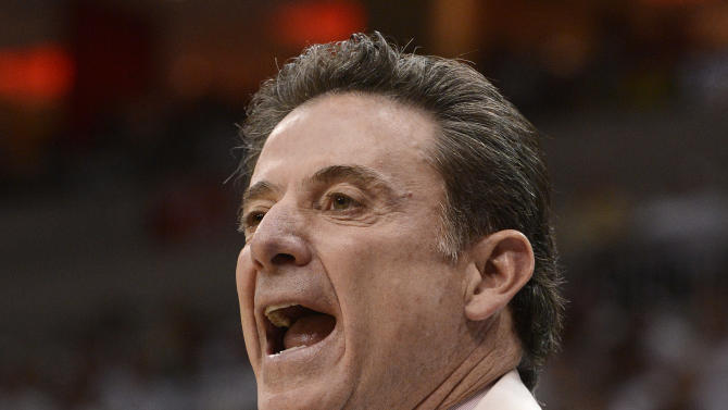 Louisville head coach Rick Pitino shouts instructions to his team during the first half of their NCAA college basketball game against Marquette, Sunday, Feb. 3, 2013, in Louisville, Ky. (AP Photo/Timothy D. Easley)
