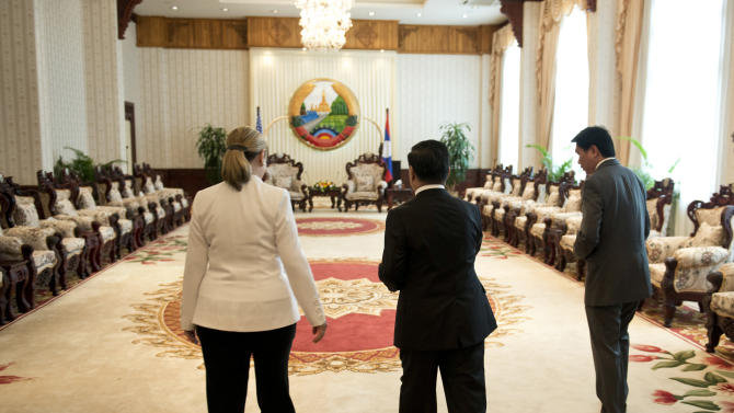 U.S. Secretary of State Hillary Rodham Clinton, left, and Laotian Prime Minister Thongsing Thammavong, center, walk to a meeting at the Prime Minister's Office in Vientiane, Laos Wednesday, July 11, 2012. Clinton became the first U.S. secretary of state to visit Laos in more than five decades, gauging whether a place the United States pummeled with bombs during the Vietnam War could evolve into a new foothold of American influence in Asia. (AP Photo/Brendan Smialowski, Pool)