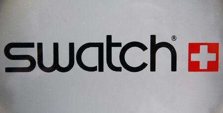 The logo of Swiss watchmaker Swatch is seen on the door of a Swatch watches shop in Strasbourg