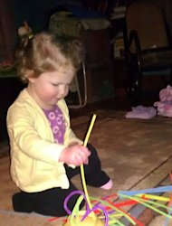 Playing with pipe cleaners to keep cabin fever at bay.