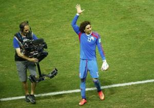 Mexico's Ochoa waves to the audience at the end of their 2014 World Cup Group A soccer match against Brazil at the Castelao arena in Fortaleza