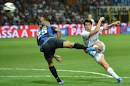 Hajduk Split&#39;s forward Ivan Vukovic (R) shoots and scores against Inter Milan during the UEFA Europa League third qualifying round football match between Inter Milan and Hajduk Split in San Siro Stadium in Milan. Italian giants Inter Milan were given a fright when they lost 2-0 at home to Hajduk Split of Croatia. But having won the first leg away 3-0 they scraped through 3-2 on aggregate