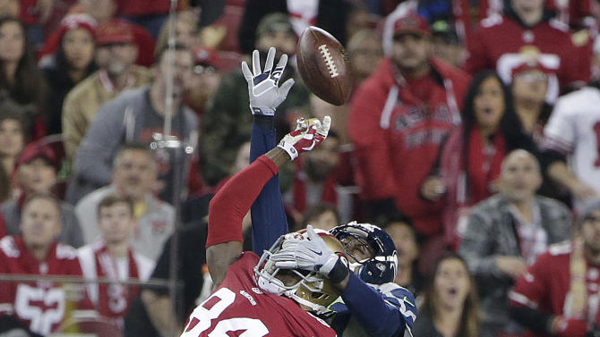Seattle Seahawks cornerback Byron Maxwell, rear, breaks up a pass intended for San Francisco 49ers wide receiver Brandon Lloyd (84) during the first quarter of an NFL football game in Santa Clara, Calif., Thursday, Nov. 27, 2014
