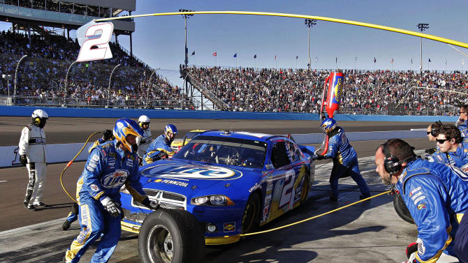 Brad Keselowski (2) pits during the NASCAR Sprint Cup Series auto race, Sunday, Nov. 11, 2012, at Phoenix International Raceway in Avondale, Ariz. (AP Photo/Matt York)