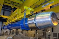 <p>Image provided by the European Organization for Nuclear Research (CERN) shows a large dipole magnet being installed into the Large Hadron Collider (LHC) in Geneva in 2007. Smashups generated at the LHC briefly generate temperatures 100,000 times hotter than the Sun.</p>