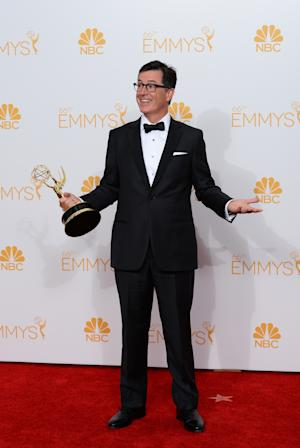 Stephen Colbert poses with the award for Outstanding Variety Series in the press room at the 66th Annual Primetime Emmy Awards at the Nokia Theatre L.A. Live on Monday, Aug. 25, 2014, in Los Angeles. (Photo by Jordan Strauss/Invision/AP)