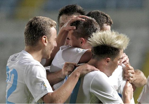 Slovenia's Josip Ilicic, center, celebrates with his teammates after he scored against Cyprus during their World Cup group E qualifying soccer match at GSP stadium in Nicosia, Cyprus, Tuesday, Sept. 1