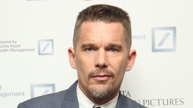 Actor Ethan Hawke poses for photographs at a British Academy of Film and Television Arts (BAFTA) photo call, during the 'Life in Pictures' event in his honor, at BAFTA headquarters in Piccadilly, central London, Thursday, Dec. 18, 2014. (Photo by Joel Ryan/Invision/AP)