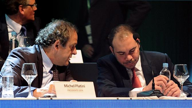Michel Platini (left) and Prince Ali chat at a meeting of CONMEBOL, at the South American confederation, in Luque, near Asuncion on March 4, 2015