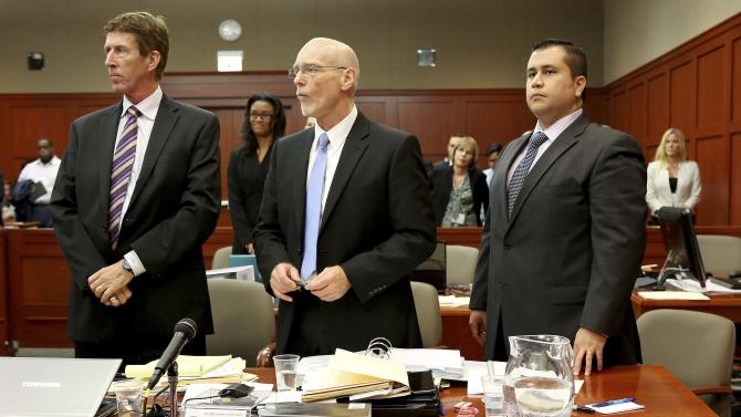 Defense attorneys Mark O'Mara, left, Don West, center, stand with George Zimmerman during Zimmerman's trial in Seminole circuit court, in Sanford, Fla., Wednesday, July 3, 2013. Zimmerman is charged with second-degree murder in the 2012 fatal shooting of slain teen Trayvon Martin. (AP Photo/Orlando Sentinel, Jacob Langston, Pool)