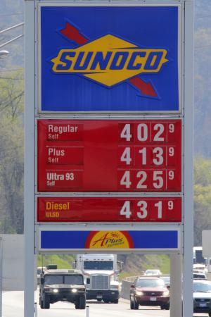 In a Sunday, April 15, 2012 photo, gasoline prices are posted at the Midway Plaza on the Pennsylvania Turnpike in Bedford, Pa. U.S. consumer prices were flat last month as cheaper gas offset modest increases for food, clothing and housing. The data indicate that inflation remains in check. The Labor Department says the seasonally adjusted consumer price index was unchanged in April, after a 0.3 percent gain in March.  (AP Photo/Gene J. Puskar)