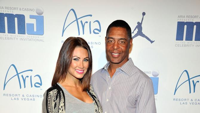 IMAGE DISTRIBUTED FOR JORDAN - Retired Hall of Fame National Football League player Marcus Allen, right, and guest arrive at the Michael Jordan Celebrity Invitational opening night dinner on Wednesday, April 3, 2013 in Las Vegas. (Photo by Jeff Bottari/Invision for Jordan/AP Images)