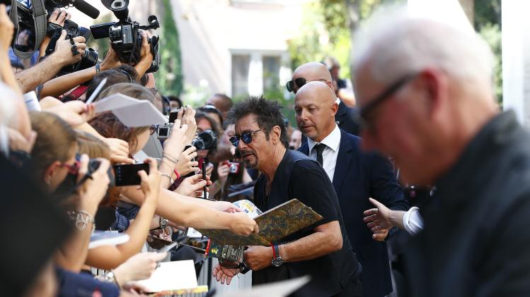 "Cast member Al Pacino signs autographs as he arrives to attend the photo call for the movie ""The Humbling"" at the 71st Venice Film Festival"