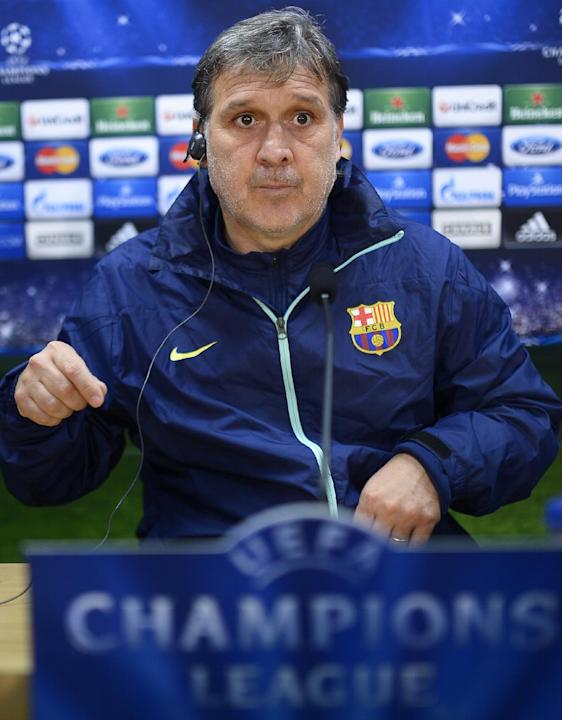 FC Barcelona's coach Gerardo Tata Martino, from Argentina, attends a news conference at the Sports Center FC Barcelona Joan Gamper in San Joan Despi, Spain, Tuesday, March 11, 2014. . FC Barcelona