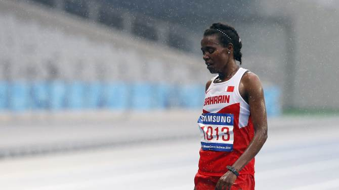 Bahrain's Gemgchu reacts after finishing third in the women's marathon during the 17th Asian Games in Incheon