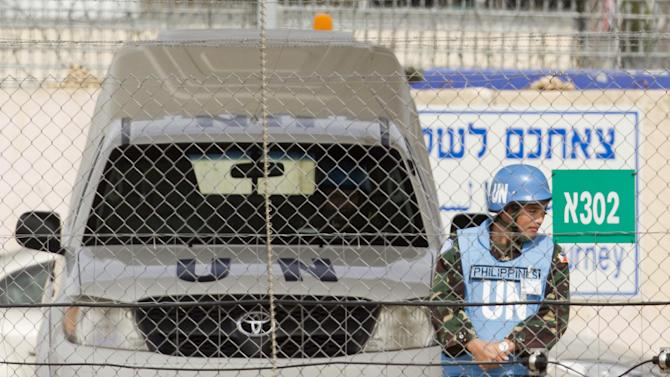 March 7, 2013 picture showing Filipino UN peacekeepers at the Quneitra checkpoint between Israel and Syria in the Golan Heights