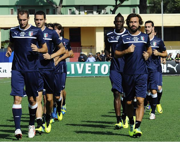 The Italian national team runs during a training session at the Giarrusso stadium in the outskirts of Naples, Monday, Oct. 14, 2013, ahead of a 2014 FIFA World Cup, Group B, qualification match agains
