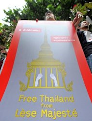 Supporters of prominent Thai historian Somsak Jeamteerasakul protest outside a police station in Bangkok in 2011. Somsak surrendered to police over the charges of insulting the monarchy, after he publicly called for the institution to be reformed. Amnesty views people incarcerated solely under the lese majeste law as prisoners of conscience