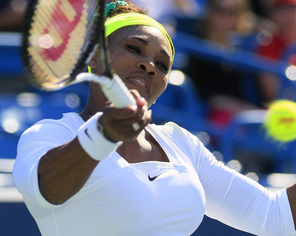 Serena Williams hits a forehand against Angelique Kerber, from Germany, during a quarterfinal at the Western & Southern Open tennis tournament on Friday, Aug. 17, 2012, in Mason, Ohio. Kerber won 6-4, 6-4. (AP Photo/Al Behrman)