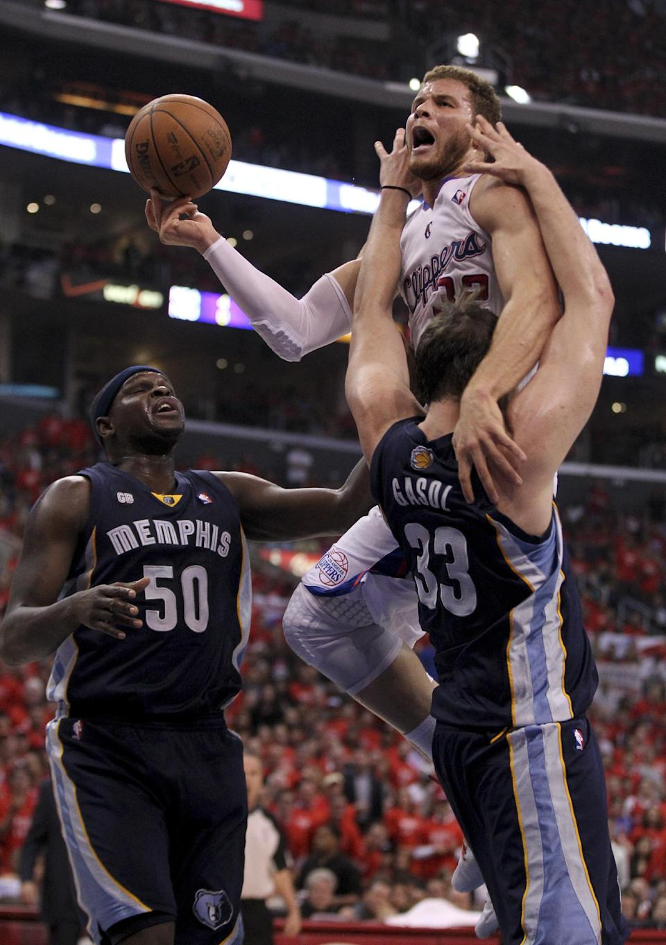 Los Angeles Clippers' Blake Griffin, right, gets called with a charging foul on  Memphis Grizzlies' Marc Gasol as Zach Randolph looks on  during the first half of a NBA first-round playoff basketball game in Los Angeles, Monday, May 7, 2012. (AP Photo/Chris Carlson)