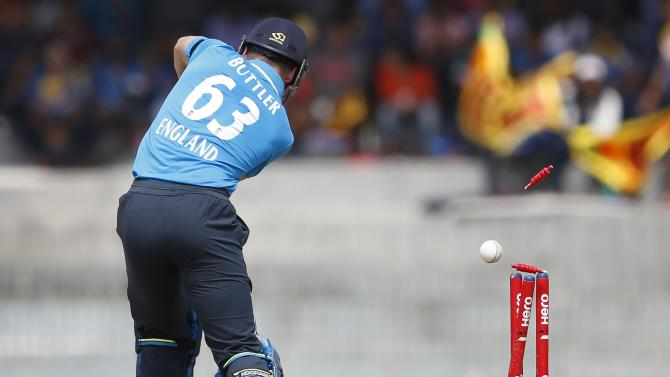 England's Buttler is bowled out by Sri Lanka's Prasad during their second ODI cricket match  in Colombo