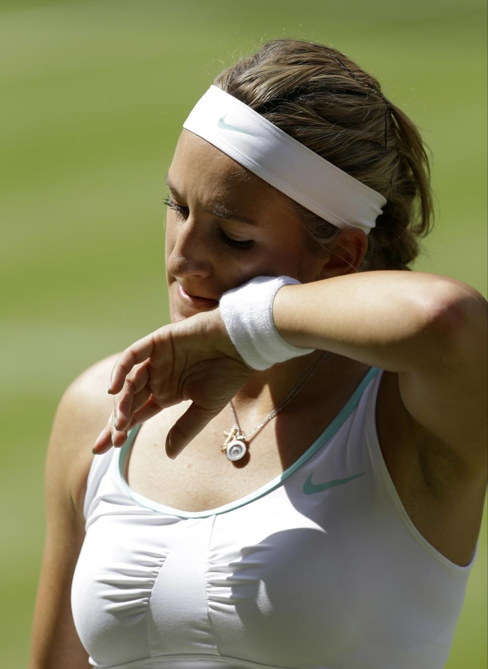 Victoria Azarenka of Belarus wipes her face during a semifinals match against Serena Williams of the United States at the All England Lawn Tennis Championships at Wimbledon, England, Thursday, July 5, 2012. (AP Photo/Alastair Grant)