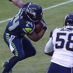 Seattle Seahawks running back Marshawn Lynch rushes for a 9-yard touchdown