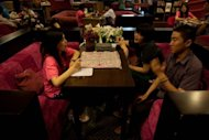 A couple is seen talking with a staff member at a singles club in Beijing. Pressure on China&#39;s women today is huge. Part of this is due to nation&#39;s one-child population control policy, which adds to the desperation of parents for their only offspring to marry and produce a grandson or granddaughter