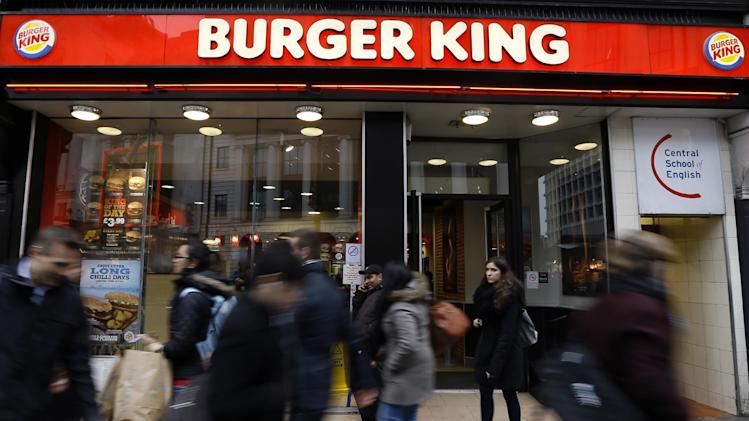 Pedestrians pass by a branch of Burger King in central London, Thursday, Jan. 24, 2013. Burger King says it has stopped buying beef from an Irish supplier whose patties in Britain and Ireland were found to contain traces of horsemeat. Officials say there is no risk to human health, but the episode has raised food security concerns. (AP Photo/Kirsty Wigglesworth)
