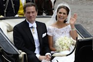 The newly wed Princess Madeleine of Sweden and New York businessman Christopher O´Neill leave in a carriage in Stockholm on June 8, 2013
