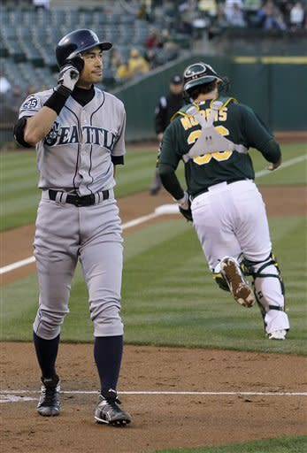 Carter's HR powers A's past Mariners 4-1 in 11th