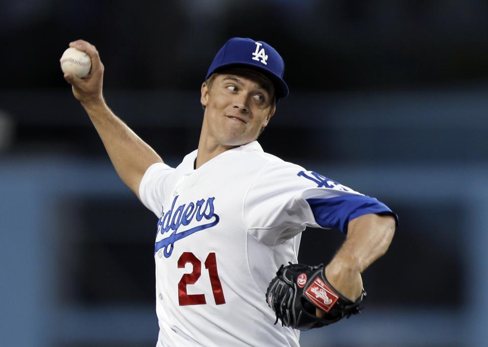 Los Angeles Dodgers starter Zack Greinke pitches to the Pittsburgh Pirates in the first inning of a baseball game in Los Angeles, Friday, April 5, 2013. (AP Photo/Reed Saxon)