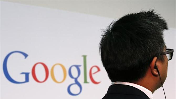 A man stands in front of a Google logo at the Chinese University of Hong Kong November 4, 2013. REUTERS/Bobby Yip/Files
