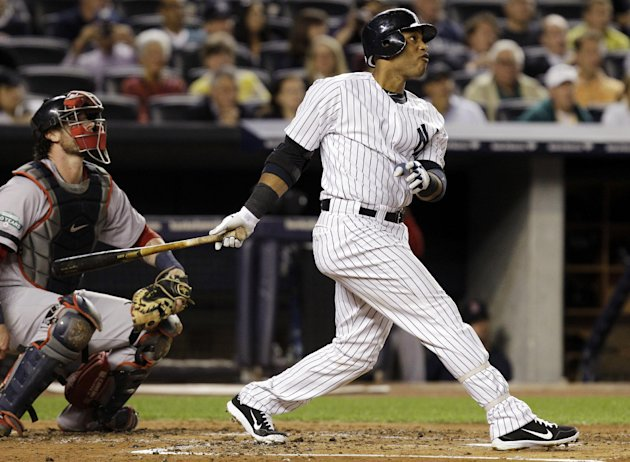 New York Yankees' Robinson Cano hits a second-inning, solo home run during their baseball game against the Boston Red Sox at Yankee Stadium in New York, Monday, Oct. 1, 2012. (AP Photo/Kathy Willens)