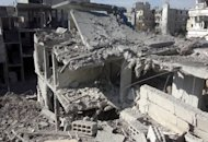 A picture released by the opposition Shaam News Network shows destruction in the Syrian capital of Damascus. A Syrian fighter jet hit targets inside Damascus for the first time on Tuesday, a watchdog said, as air strikes pounded rebel bastions around the country and an air force general was shot dead