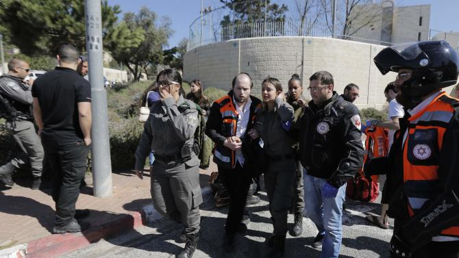 An Israeli border police woman speaks to a medic at the scene of an attack Jerusalem
