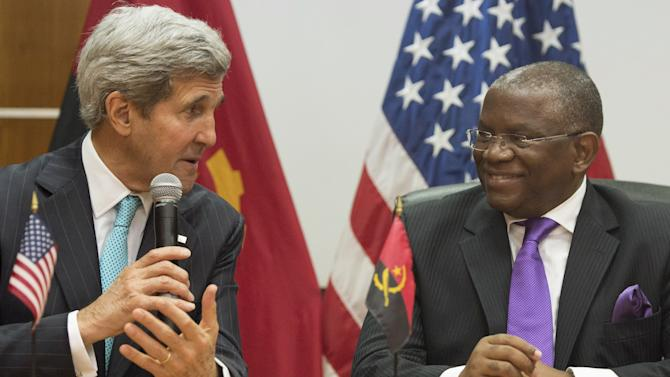 Foreign Minister Georges Rebelo Chicoti, right, of Angola with US Secretary of State John Kerry speak to the media following meetings at the Ministry of Finance in Luanda, Angola, May 5, 2014. Kerry on May 4 praised oil-rich Angola's leadership role in efforts to solve long-drawn conflicts on the African continent. (AP Photo/Saul Loeb, Pool)