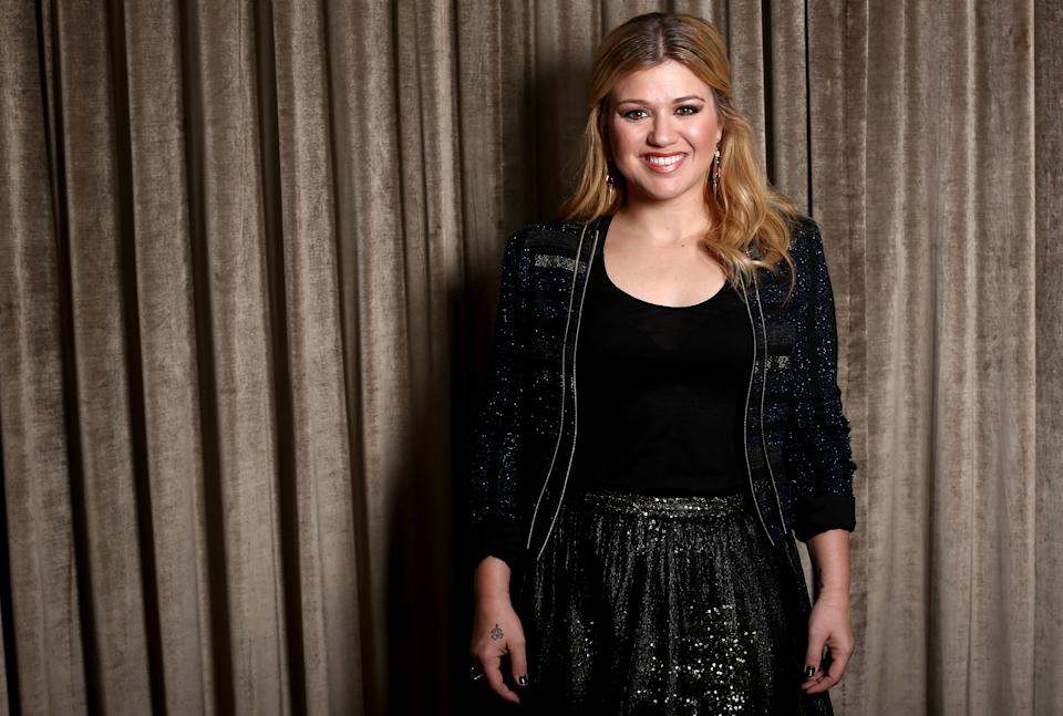 "In this Monday, Nov. 5, 2012 photo, musician Kelly Clarkson poses for a portrait in Los Angeles.  Clarkson's newest album, Greatest Hits: Chapter One,"" is releasing on Monday, Nov. 19, 2012. (Photo by Matt Sayles/Invision/AP)"