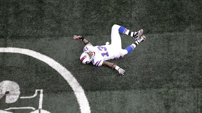 "Buffalo Bills wide receiver Steve Johnson celebrates after scoring a touchdown during the second quarter of an NFL football game against the New York Jets on Sunday, Nov. 27, 2011, in East Rutherford, N.J. Johnson drew a penalty for going to the ground while imitating the Jets' ""flight"" celebration. ""I was just having fun and part of having fun ended up being a penalty and a touchdown for the Jets,"" Johnson said. ""It was a stupid decision by myself."" (AP Photo/Julio Cortez)"