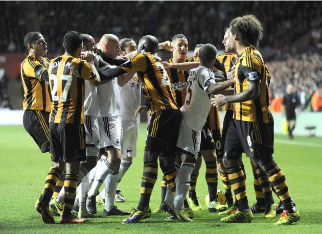 Swansea City and Hull City players scuffle during their English Premier League soccer match at the Liberty Stadium in Swansea