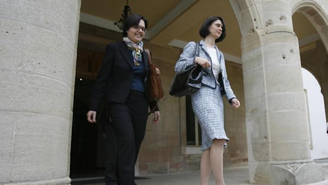 Delia Velculescu, right, head of Troika (IMF), and European Central Bank official Isabel von Koppen Mertes leave from the Presidential palace after their meeting with Cyprus President Nicos Anastasiades, in Nicosia, Cyprus, Thursday , March 7, 2013. Senior officials from Cyprus' prospective international lenders are starting a new round of talks with Cypriot authorities with the aim of finalizing a financial rescue package for the country by the end of the month. (AP Photo/Philippos christou)