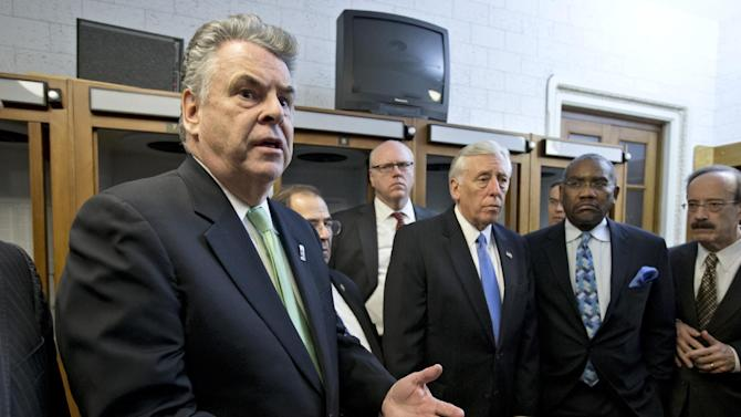 Rep. Peter King, R-N.Y., left, joined by other New York area-lawmakers affected by Superstorm Sandy, express their anger and disappointment after learning the House Republican leadership decided to allow the current term of Congress to end without holding a vote on aid for the storm's victims, at the Capitol in Washington, early Wednesday, Jan. 2, 2013. (AP Photo/J. Scott Applewhite)
