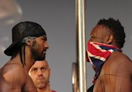 David Haye (L) and Dereck Chisora face each other across a fence following their weigh-in in central London, on July 12, ahead of their Saturday&#39;s fight